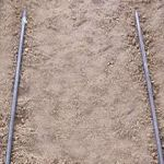 NEW PAVER GUIDE SCREED RAILS ON ROADBASE.jpg